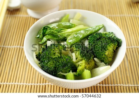 Delicious bowl of freshly cooked Chinese vegetables ready to serve. - stock photo