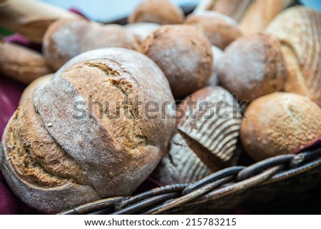 Delicious bread and rolls in a wicker basket  - stock photo