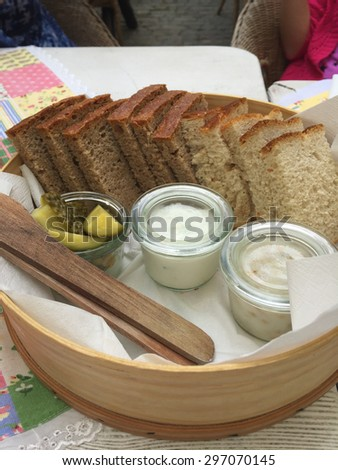 Delicious bread in a basket on table. - stock photo