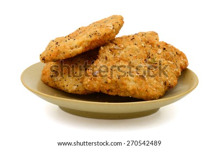 delicious breaded fish on plate isolated on white  - stock photo