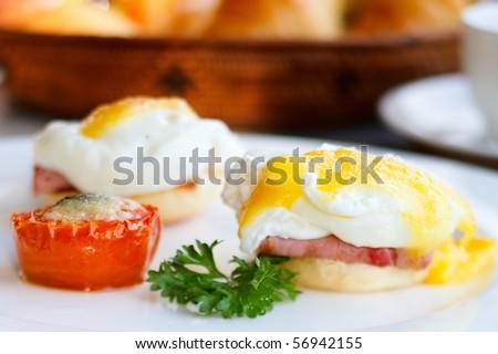 Delicious breakfast. Eggs benedict with ham on toast - stock photo