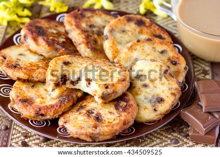 Delicious breakfast meal with cottage cheese - cheese pancakes with chocolate and cocoa selective focus - stock photo