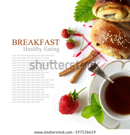 Delicious breakfast of tea, fresh bread rolls with sesame seeds and strawberries. isolated on white background. top view - stock photo