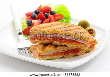 Delicious breakfast panini served with fresh fruit.