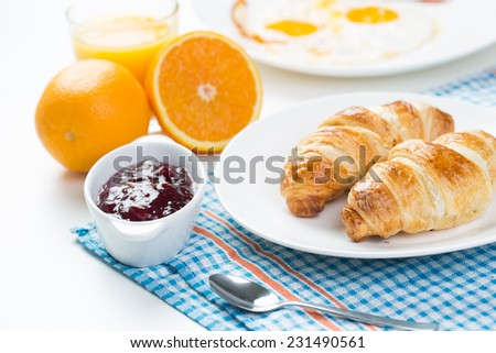 delicious breakfast with croissants and juice - stock photo