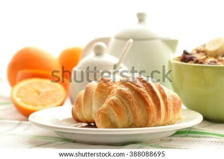 Delicious breakfast with fresh croissants on wooden table, close-up, horizontal