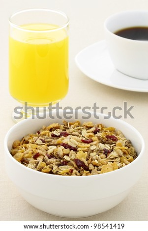 delicious breakfast with fresh orange juice, hot coffee and a healthy bowl of cereal. - stock photo