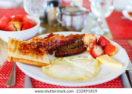 Delicious breakfast with fried eggs, bacon and toast - stock photo