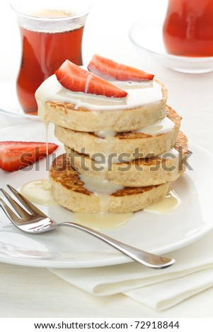 Delicious breakfast with pancakes and strawberry on white background
