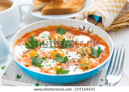 delicious breakfast with quail eggs in a pan, close-up - stock photo