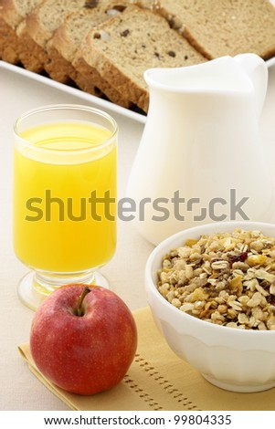 delicious breakfast with whole grain bread,fresh red apple and a healthy bowl of cereal. - stock photo