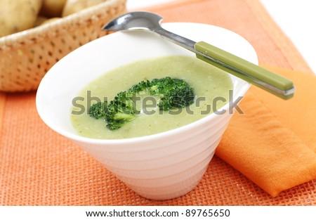 Delicious broccoli cream soup with potato - stock photo