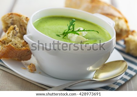 Delicious broccoli cream soup with rye bread . International cuisine meal.Close-up shot. - stock photo