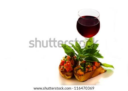 delicious bruschetta appetizer on white background - stock photo