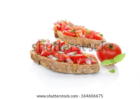 Delicious bruschetta eating. Two ciabatta slices with chopped tomatoes, onion and fresh herbs isolated on white background. Healthy vegetarian and vegan eating. - stock photo