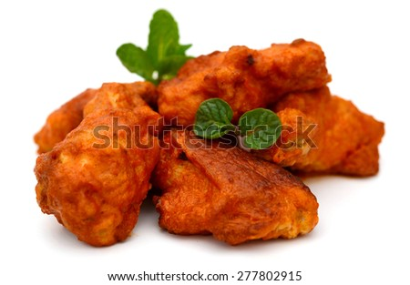 delicious buffalo chicken wings isolated on white  - stock photo