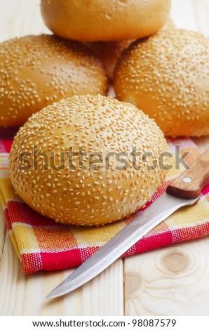 delicious bun with sesame seeds - stock photo