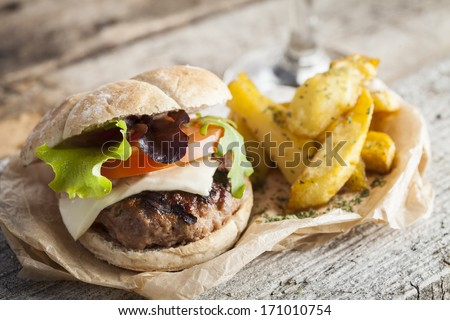Delicious burger with beef, tomato, cheese and lettuce