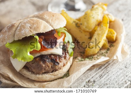 Delicious burger with beef, tomato, cheese and lettuce - stock photo