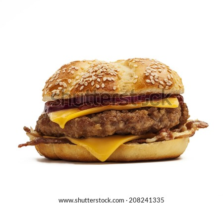 Delicious burger with cheese, onion, bacon  - stock photo
