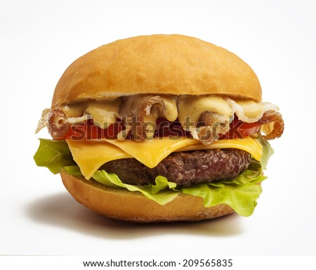 Delicious burger with cheese, tomatoes, bacon and lettuce - stock photo
