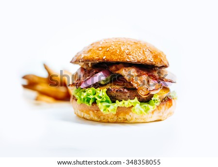Delicious burger with fried potato isolated on white - stock photo
