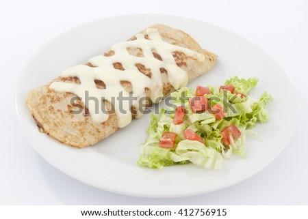 Delicious burrito brunch of sausage  on white plate - stock photo