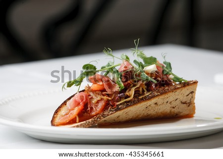 Delicious Cabbage appetizer with bacon on sour-sweet bread