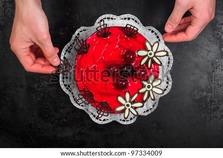 Delicious cake on dark background - stock photo