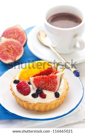 Delicious cake with custard cream and fresh fruits.
