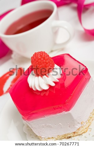 Delicious cake with whipped cream, jelly and raspberry candy - stock photo
