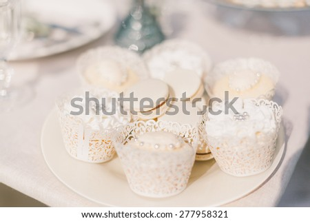 delicious cakes and macaroons at the wedding table - stock photo