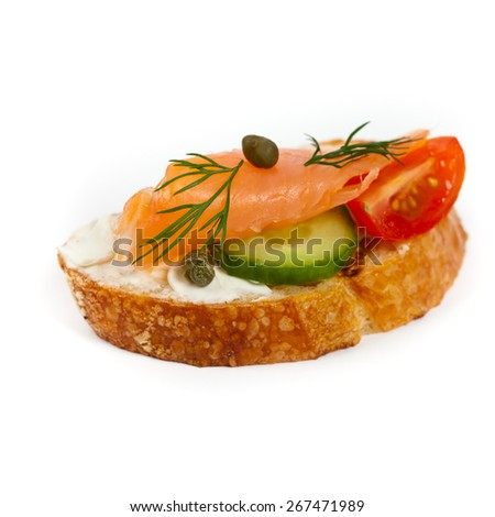 Delicious canape with smoked salmon and cream cheese on white background. Selective focus. - stock photo