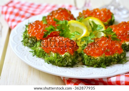 Delicious canapes with red caviar in the shape of a heart.Festive appetizer. - stock photo