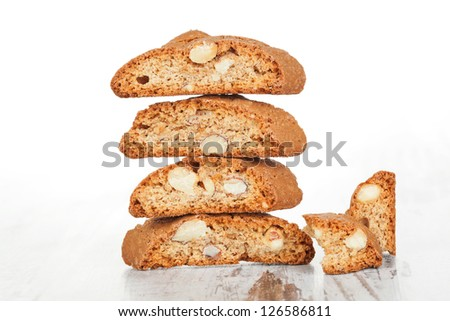 Delicious cantuccini cookie stack isolated on white wooden texture. Culinary traditional italian sweet dessert. - stock photo