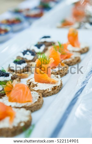 Delicious catering canapes on a buffet table.(Selective Focus)
