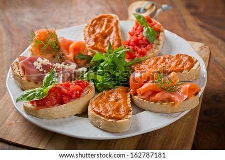 delicious catering canapes on plate - stock photo