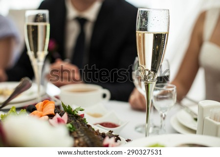 delicious champagne on the beautifully decorated brides and grooms table - stock photo