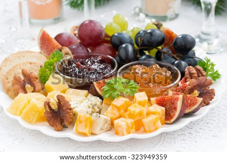delicious cheese and fruit plate to the holiday, closeup