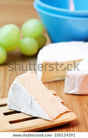 delicious cheese brie on a table - stock photo