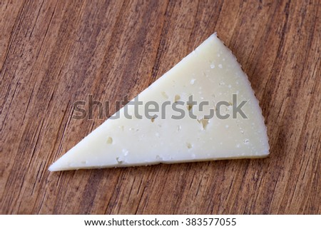 Delicious cheese from sheep in triangles - stock photo