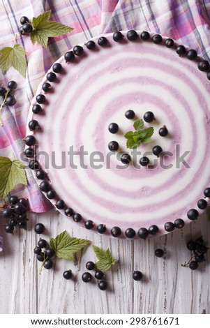 Delicious cheesecake striped black currant close up on the table. vertical top view - stock photo