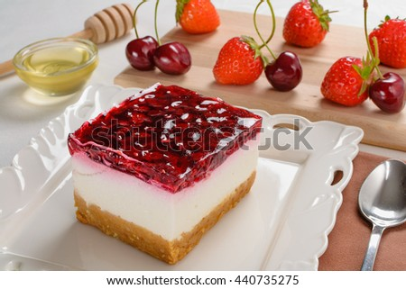 Delicious cheesecake with berries,fresh strawberry and cherry cheesecake on table.