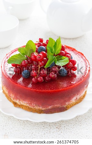 Delicious cheesecake with berry jelly on a plate, vertical - stock photo