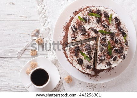 Delicious cheesecake with chocolate cookies closeup on a plate. horizontal view from above