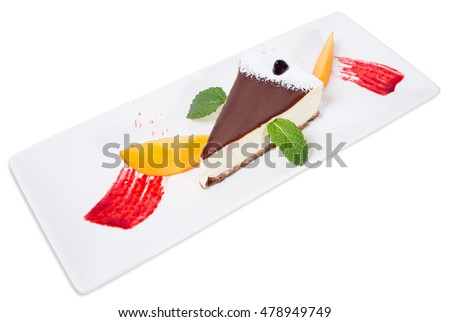Delicious cheesecake with mango and red jam. Isolated on a white background.