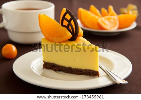 Delicious cheesecake with orange and chocolate. - stock photo