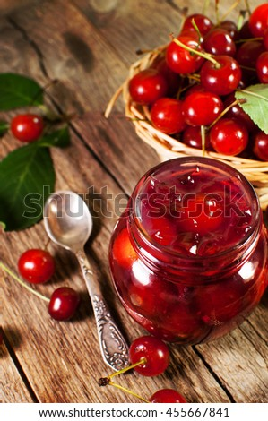 delicious cherry jam on a wooden background. - stock photo