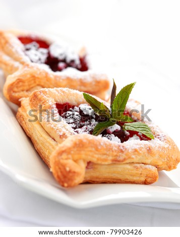 Delicious Cherry puff pastry with powdered sugar