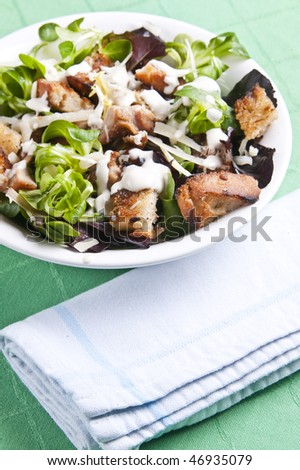 Delicious chicken caesar salad with tasty dressing